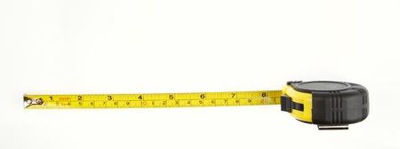 cinta de medir: Cinta métrica en el fondo llano Foto de archivo