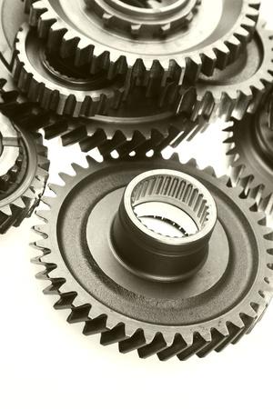 meshing: Closeup of teeth of steel gears meshing together