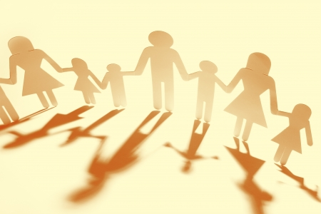 Family holding hands, casting shadows  photo