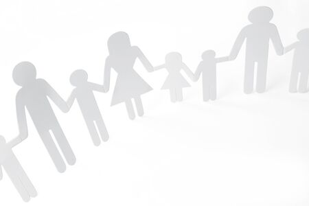 unity is strength: Family holding hands on plain background