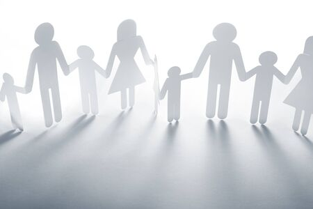 Family holding hands on plain background photo