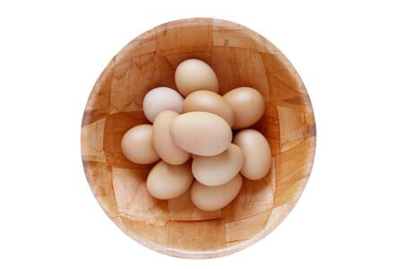 Closeup of eggs in bowl on plain background Stock Photo - 17338582
