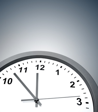 Closeup of clock on grey background photo