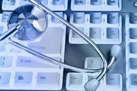 Stethoscope on keyboard Stock Photo - 17361037