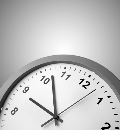 Closeup of clock on grey background Stock Photo - 17381123