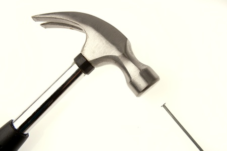 Hammer and nail on plain background Stock Photo - 17381063