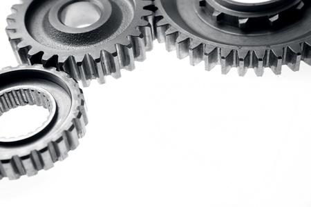 Closeup of three metal gears on plain background Stock Photo - 17381122