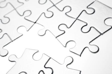 Jigsaw puzzle pieces apart on white Stock Photo - 17381096