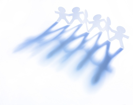 Group of six paper chain people holding hands together Stock Photo - 17381077