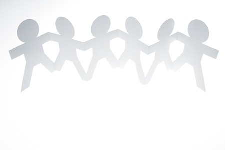 Group of paper chain people holding hands together. Stock Photo - 17455305