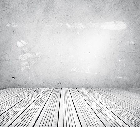 floorboards: Wooden floorboards and concrete wall