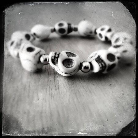 Closeup of spooky skulls bracelet photo