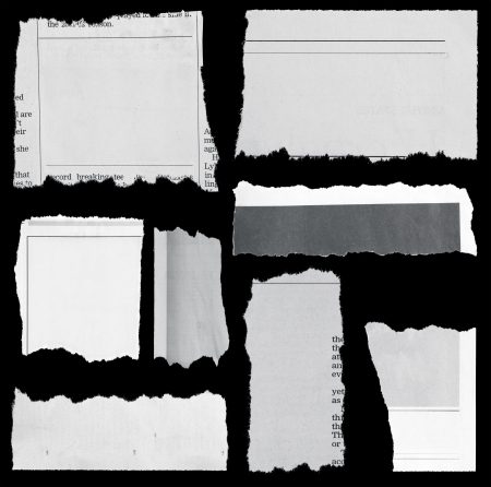 Pieces of torn paper on black  Copy space photo