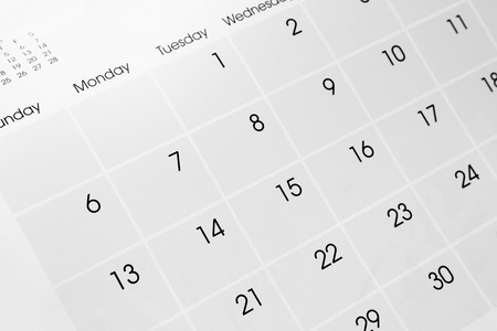 Closeup of dates on calendar page photo
