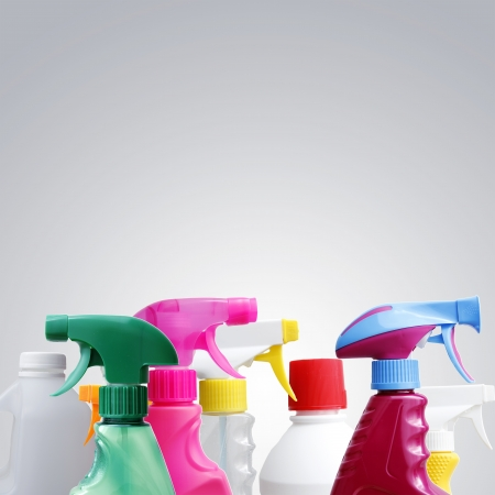 household objects equipment: Cleaning bottles closeup. Grey background