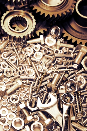 spare: Steel gears, nuts, bolts, and wrenches