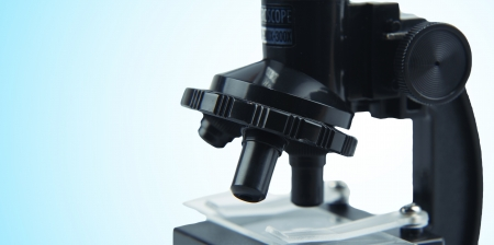 Microscope on color background  Copy space Stock Photo - 18139399