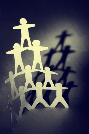 Human team pyramid and shadow photo