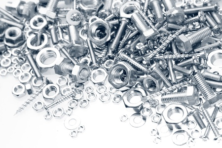 Chrome nuts and bolts closeup on plain background Stock Photo
