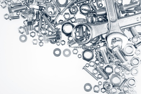 spanners: Wrenches, nuts and bolts on plain background Stock Photo