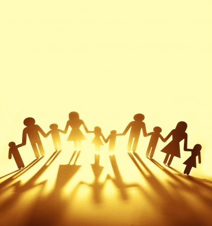bright future: Family holding hands. Copy space Stock Photo