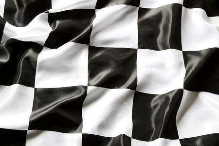 schwarz weiss kariert: Checkered schwarz-wei�en Flagge Nahaufnahme Lizenzfreie Bilder