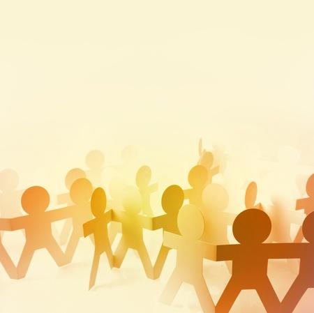 teamwork hands: Paper doll people holding hands