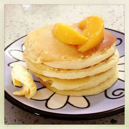 flapjacks: Stack of pancakes, peaches and butter Stock Photo