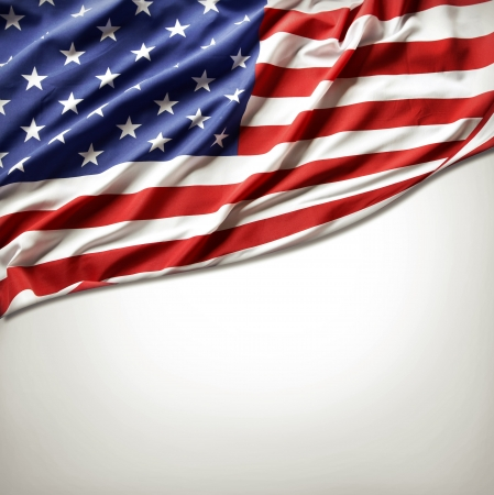 Closeup of American flag on plain background photo