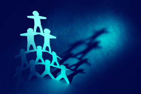 together concept: Human pyramid paper doll people
