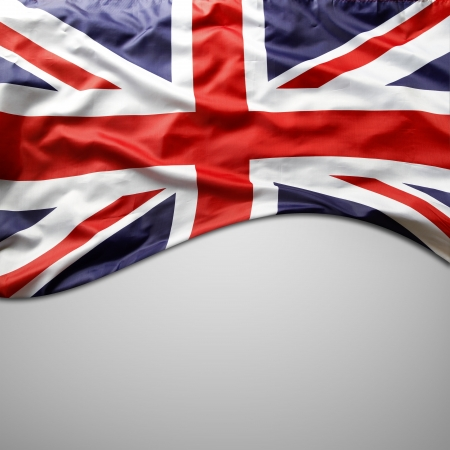 Closeup of Union Jack flag on plain background  Copy space photo