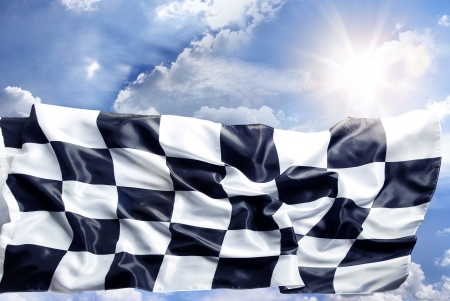 first place: Checkered flag and sunny sky