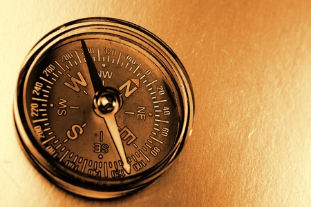 surveying: Single compass on brown background Stock Photo