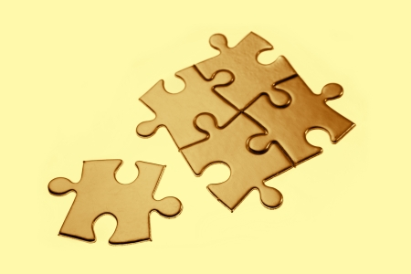 Jigsaw puzzle pieces on brown background photo