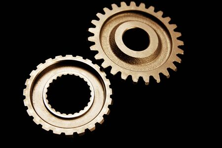 interlink: Two cogwheels together on dark surface  Stock Photo