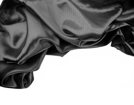 silk fabric: Closeup of rippled black silk fabric on plain background