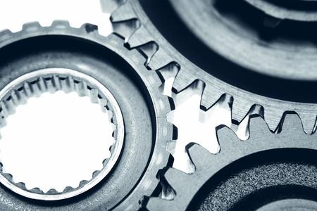 three wheel: Closeup of three metal cog gears Stock Photo