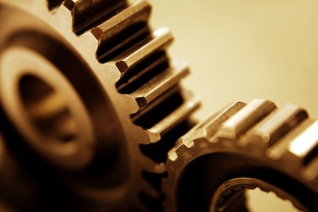 Closeup of two metal cog gears photo