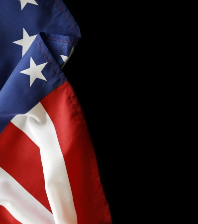 Closeup of American flag on black background photo