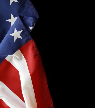 american flags: Primer plano de la bandera estadounidense en el fondo negro