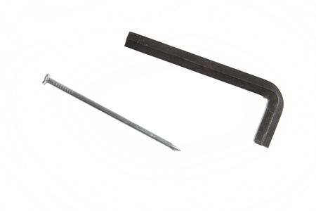 hex key: Hex key and nail isolated on plain background