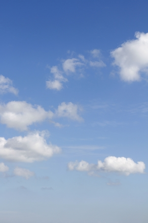 Fluffy clouds in a blue sky Stock Photo