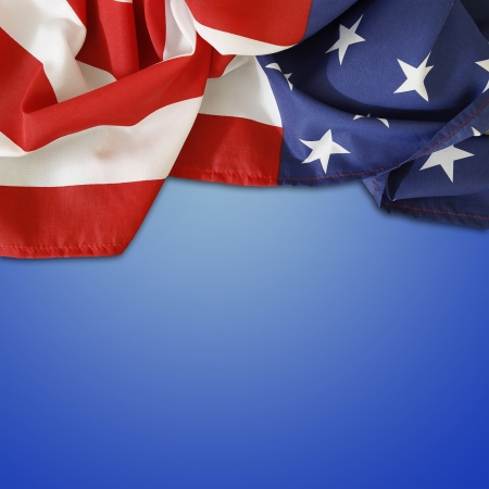 Closeup of American flag on blue background photo