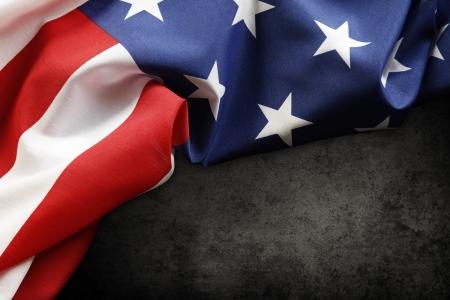 american flags: Primer plano de la bandera estadounidense en el fondo oscuro