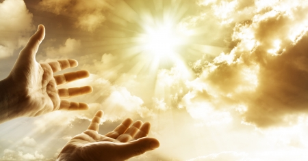 sun worship: Hands reaching for the sky  Stock Photo