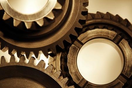 gearbox: Closeup of three metal cog gears Stock Photo