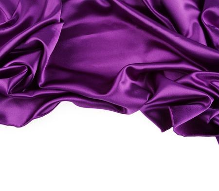 purple silk: Closeup of purple silk fabric on white background Stock Photo