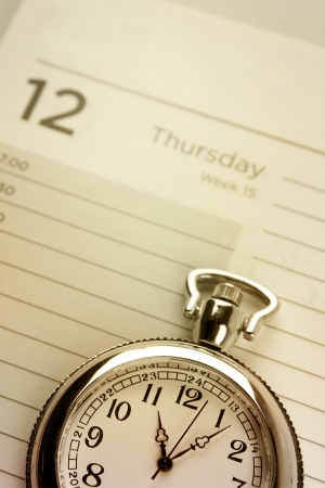 schedule appointment: Pocket watch on diary page  Stock Photo