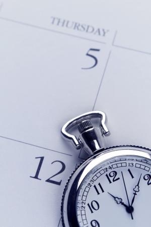 punctual: Primer plano de reloj en el calendario Foto de archivo