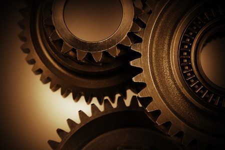 Closeup of three metal cog gears photo